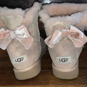 Light pink Uggs with velvet bows